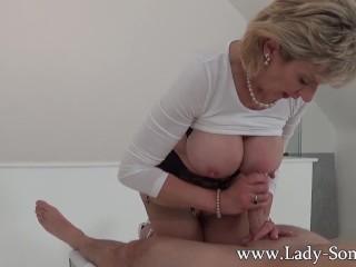 Milf Lady Sonia gives hot handjob on massage table