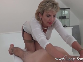 Preview 1 of Milf Lady Sonia gives hot handjob on massage table