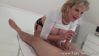 Milf Lady Sonia gives hot handjob on massage table