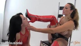 Preview 3 of Horny babe in nylon body suit licks lezdoms boots and fucks big strapon