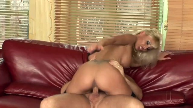 Blonde fucked on a leather couch in fishnet stockings and stilettos
