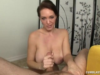 Charlee speaking and jerking a cock on the bed 9