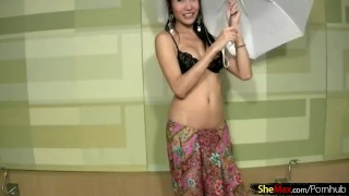 Dancing Asian ladyboy strips out of black lingerie and jerks