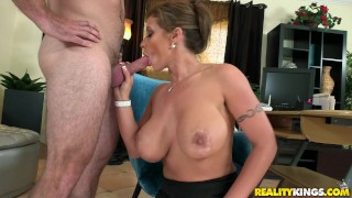 Screen Capture of Video Titled: Reality Kings - Milf shows off her huge tits