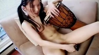 Asian babe uses her toy for some pussy action