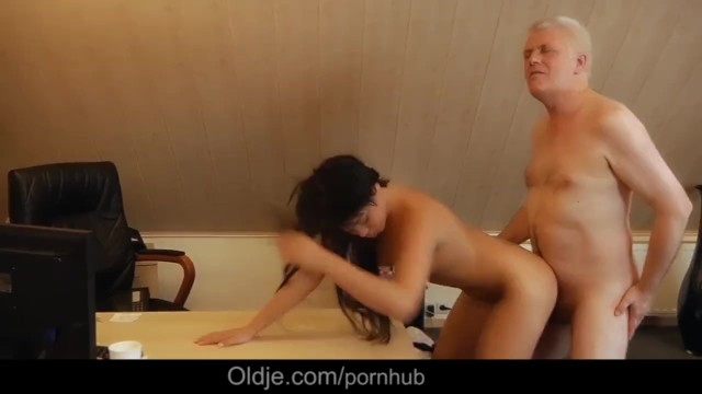 Old Nick fucks sweet girl on his bureau and jizz her cute face