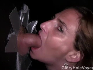 Redhead MILF Sucks Two Cocks in Glory Hole