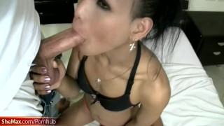 Slender Thai ladyboy poses lingerie and gives superb handjob