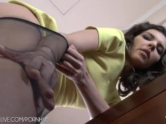 Long legged brunette in sexy stockings masturbating