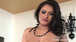 Dolled up Charley plays with her pierced pussy