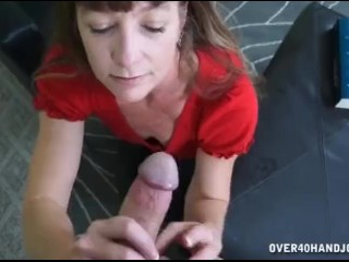 Horny milf jacks off a young man