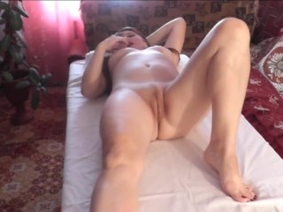 Masseur makes massage beautiful brunette stimulates nipples and wet orgasm