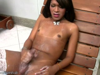 Black latina tranny beauty poses in white lingerie outdoors