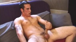 Tattooed skater strokes his cock