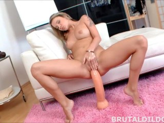 Blonde babe fucking her pussy with two massive brutal dildos in HD