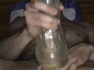 Young twink stroking his big cock and fucking a fleshlight