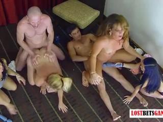 Four beautiful women play strip electrocution game!