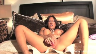 Busty brunette Capri toys her pussy on the bed