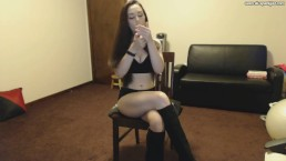 Victoria in black boots smoking and playing