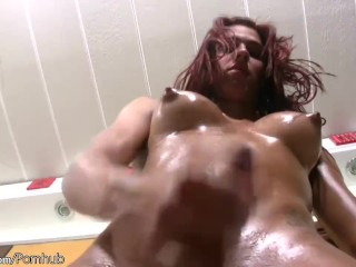 Redhead shedoll teases perfect oiled up body while jerking
