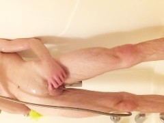 Young twink in shower stroking and playing with cock and ass