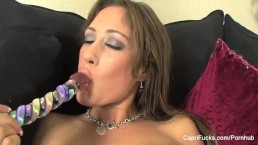 Busty babe Capri Cavanni toys her pussy with a glass dildo