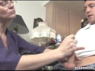 Naughty milf jerking a cock