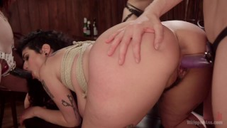Screen Capture of Video Titled: Dyke Bar 4: Wet t-shirt contest winner spanked, & DP strap-on FUcked!