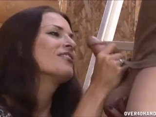 Milf jerks off the worker