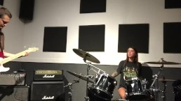 Felicity Feline drumming and plays some stoner rock behind the scenes
