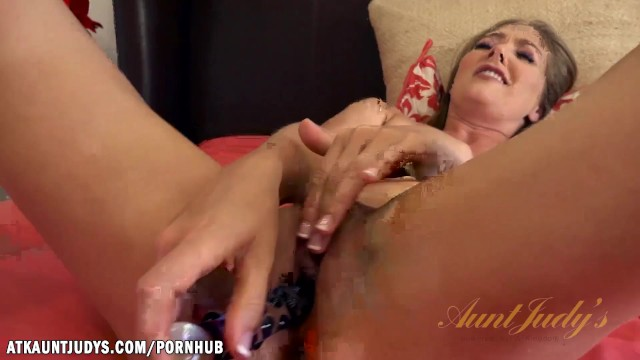 Into her wet pussy - Star slides her glass dildo into her wet pussy
