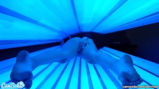 Teen latina college student gives lesbian pussy a massage in tanning bed