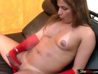 Brunette shemale slips out of her red lingerie to masturbate