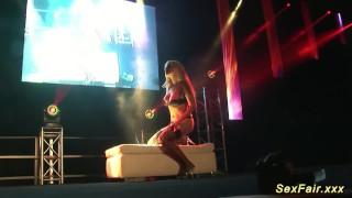 busty milf stripping on public stage porno