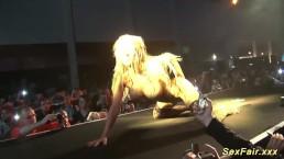 busty milf stripping on public stage