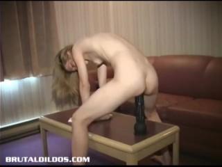 Skinny blonde amateur bouncing on a massive black dildo
