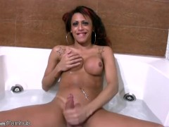Big boobed redhead TS jerks off her massive cock in bathtub