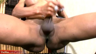 Black chick with dick takes off her bra and exposes big tits