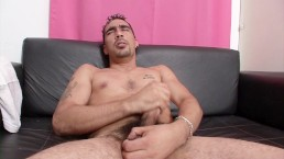 Beefy latino DILF strips his undies and jerks off