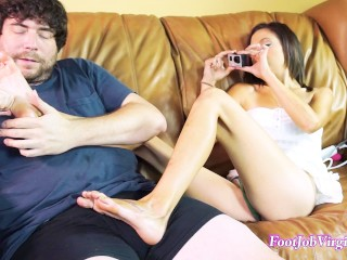 Sexy Jamie gives a footjob whilte cumming from a vibrator