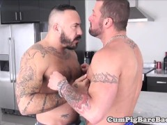 Tattooed muscle bear barebacking after rimjob