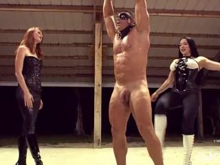 2 Mistresses Ballbusting a Muscular Bodybuilder Slave (Femdom) Tied up