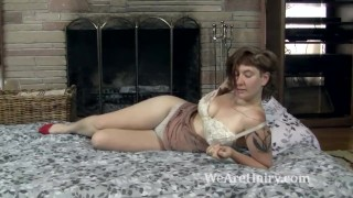 Sylvia Sinclair strips naked in bed looking hot