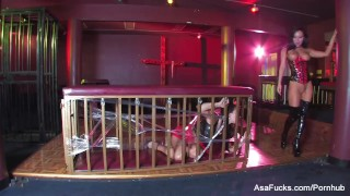 Asa Akira gets fucked on top of a caged Sophia Santi