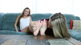 Screen Capture of Video Titled: Teens Kimber Lee & Ashlynn Worship Each Others Feet!