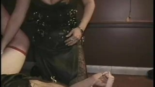 Two naughty studs enjoy having some dungeon fun with a hot domina porno