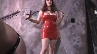 Stunning latex-clad redhead domina has some fun with her man  redhead femdom old spanking kink big tits dominatrix babe nipple pinching latex dungeon bdsm sex toys whipping