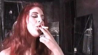 Stunning latex-clad redhead domina has some fun with her man  nipple pinching big tits spanking dominatrix babe bdsm redhead femdom old dungeon kink latex whipping sex toys