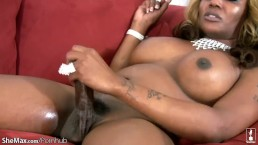 Black mature TS with blond curly hair strips down and wanks
