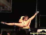 hot flexible busty babe on stage